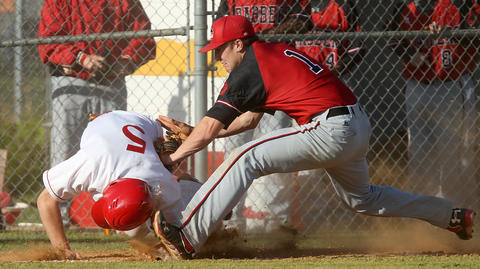 Linzie Coleman of Gloucester is tagged out in a rundown by pitcher Patrick Jackowski of Hampton during the sixth inning Thursday in Gloucester. No Mags, No Sales, No Internet, No TV