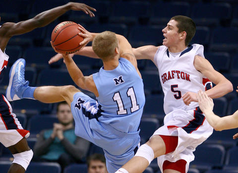 Evan Sperling of Grafton goes for the block of Cody Brooks of Millbrook during the second half of their Group AA Division 4 quarter-final game at the Ted Constant Center Saturday. No Mags, No Sales, No Internet, No TV