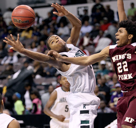 Gregory Alexander of Kecoughtan goes after a rebound under pressure from Jacorey Smith of King's Fork duirng the second half of their Eastern Region Tournament game in Norfolk Sunday. No Mags, No Sales, No Internet, No TV