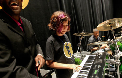 Jasper Smith gets some help on keyboards from blues camp instructor Fernando Jones during a rehearsal at the American Theater.