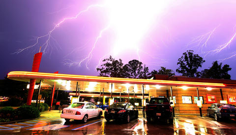 Lightning rolls through the sky over Sonic restaurant in the Denbigh section of Newport News, Virginia, Saturday, June 30, 2012, as severe thunderstorms moved through the area.