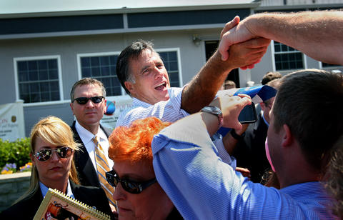 Presidential candidate Gov. Mitt Romney works the crown after delivering an energy related speech afternoon in Portsmouth.