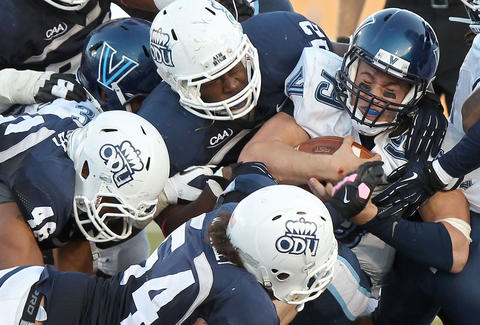 Villanova quarterback John Robertson is stopped by Craig Wilkins and the Old Dominion defense as he tries to scramble during the fourth quarter.