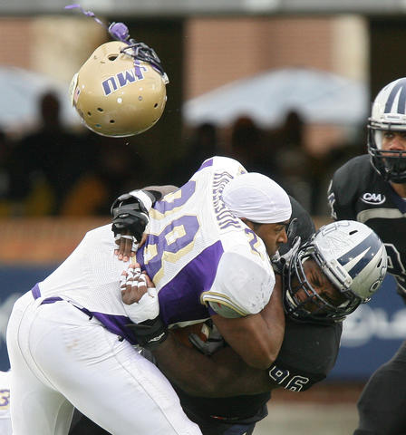 Jordan Anderson of James Madison loses his helmet as he is hit by Ronnie Cameron of Old Dominion during the fourth quarter at ODU