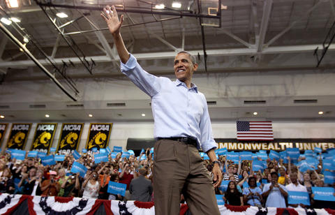 President Barack Obama waves to a packed Siegel Center Saturday May, 12 in Richmond as he kicked off his 2012 re-election campaign.