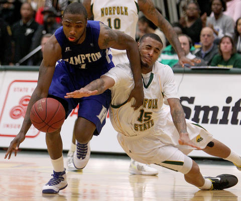 Rodney McCauley of Norfolk State tries to get the loose ball from Darrion Pellum of Hampton University during the second half Saturday  in Norfolk. No Mags, No Sales, No Internet, No TV