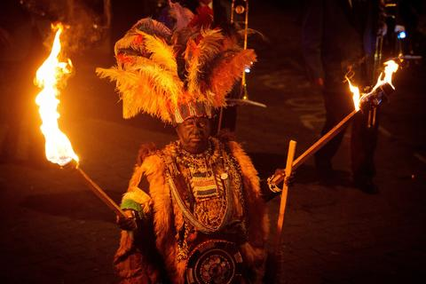 A participant in costume holds aloft torches during the Bonfire Night celebrations on November 5, 2013 in Lewes, Sussex in England.Bonfire Night is related to the ancient festival of Samhain, the Celtic New Year. Processions held across the South of England culminate in Lewes on November 5, commemorating the memory of the seventeen Protestant martyrs. Thousands of people attend the parade as Bonfire Societies parade through the narrow streets until the evening comes to an end with the burning of an effigy, or 'guy,' usually representing Guy Fawkes, who died in 1605 after an unsuccessful attempt to blow up The Houses of Parliament.