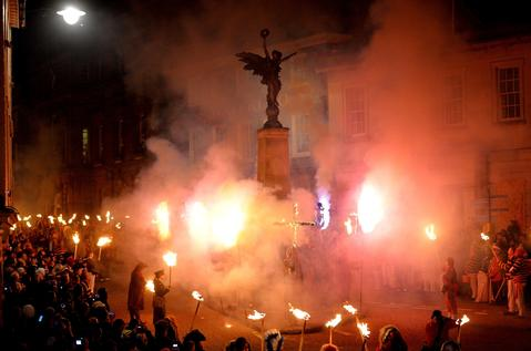 Bonfire societies parade through the streets during the Bonfire Night celebrations on November 5, 2013 in Lewes, Sussex in England. Bonfire Night is related to the ancient festival of Samhain, the Celtic New Year. Processions held across the South of England culminate in Lewes on November 5, commemorating the memory of the seventeen Protestant martyrs. Thousands of people attend the parade as Bonfire Societies parade through the narrow streets until the evening comes to an end with the burning of an effigy, or 'guy,' usually representing Guy Fawkes, who died in 1605 after an unsuccessful attempt to blow up The Houses of Parliament.