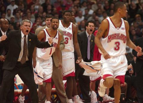 Gary Williams, Byron Mouton and Ryan Randle react after Juan Dixon hit a big 3-pointer.