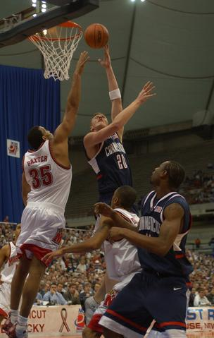 Lonny Baxter tries to block the shot of UConn's Justin Brown.