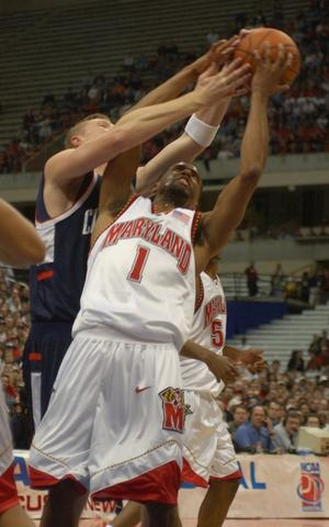 Byron Mouton and UConn's Justin Brown go after a rebound.