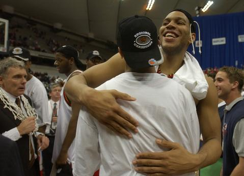 Lonny Baxter celebrates with Juan Dixon (in hat).