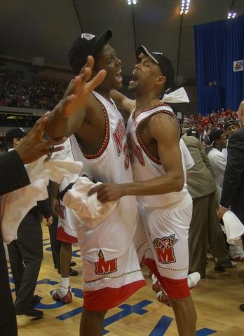 Ryan Randle and Byron Mouton celebrate the victory.