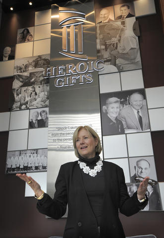 Marianne Rowan-Braun, Vice President of UMMC, stands in front of the Heroic Gift display in the lobby.