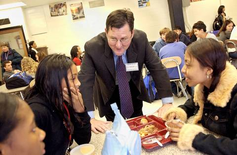 Charlie Trotter talks in 2001 with Lincoln Park High School freshman, from left, Raquia Tyler, 15, Jasmin Salas, 14, and Maybelina Serna, 14,after a lunch prepared by Trotter's chefs. The meal, served to about 560 freshman and about 200 staff members, included Amish Chicken with Parmesan and Serrano Ham and Organic Vegetable Lasagna with Tomato. Trotter was at the school as part of the Principal for a Day program in which about 1,600 area corporate and civic leaders volunteered in Chicago Public Schools.