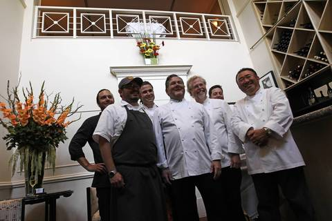 Charlie Trotter poses with the evening's chefs David Myers,from left, Sean Brock, Maxime Bilet, Charlie Trotter, Nathan Myhrvold, Michael Rotondo and Tetsuya Wakuda before Trotter's 25th anniversary dinner.
