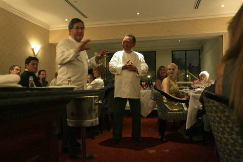 Charlie Trotter and guest chef Tetsuya Wakuda discuss Wakuda's Tian of Queensland steamed spanner crab dish during Charlie Trotter's 25th anniversary dinner.