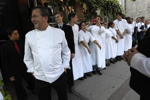 Charlie Trotter waits with his staff before a curbside greeting for Chicago Mayor Rahm Emanuel before Charlie Trotter's 25th anniversary dinner.
