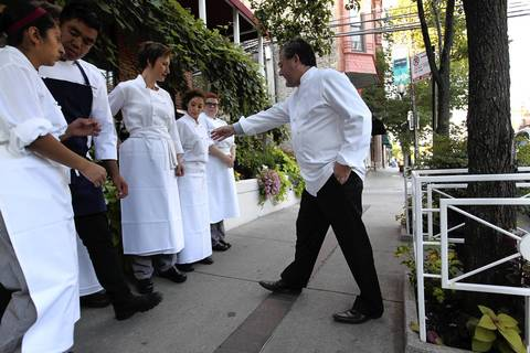 Charlie Trotter straightens his staff as while organizing a curbside greeting for Chicago Mayor Rahm Emanuel.