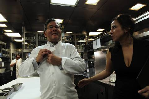 Charlie Trotter and Jennifer Trotter in kitchen during Charlie Trotter's 25th anniversary dinner.