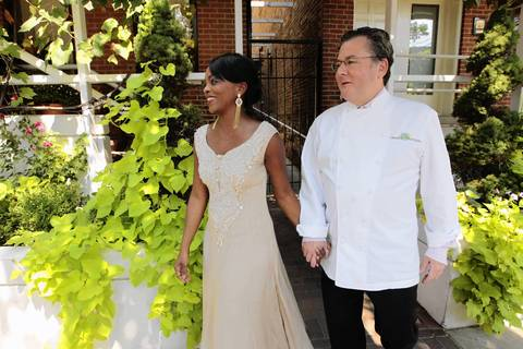 Rochelle Smith Trotter, left, and Chef Charlie Trotter leave Trotters' restaurant for a street sign dedication.
