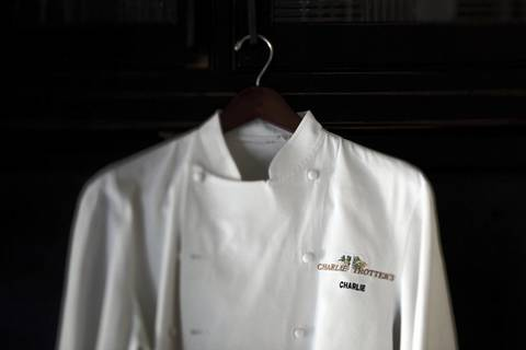 A coat worn years ago by Charlie Trotter at his restaurant.