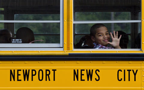 Photo Of The Week: Aug 24-Aug 30, 2013 A student waves as buses arrive at Greenwood Elementary School on the first day of school on Tuesday.