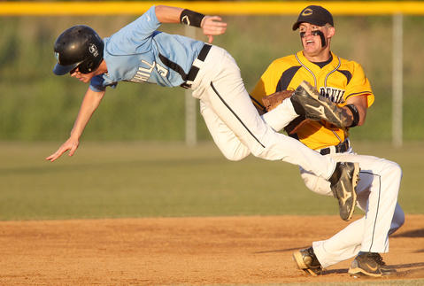 "Photo Of The Week: June 1-June 7, 2013   Luke Patterson of Warhill dives past JP Gorby of Culpeper making it safe to second base during the fourth inning Friday at Warhill.   ""This is a somewhat unusual baseball photo. Normally a runner trying to steal second will slide into the base. As I followed the runner down the baseline he surprisingly went airborne to get past the shortstop and land safe at second."""