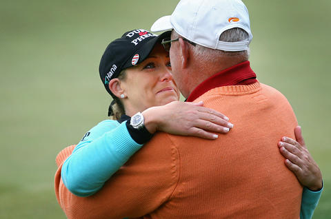 Photo of the Week: May 4-May 10, 2013   Cristie Kerr hugs her father Michael after winning the Kingsmill Championship Sunday in Williamsburg. This was the first time her father and been present when she won a tournament.  This is a different sort of sports celebration picture. Right after Cristie Kerr sank the putt that won her the Kingsmill Championship she asked for her father who had never seen her win a tournament before. I see a lot of emotion in her eye as she looks up at her dad.