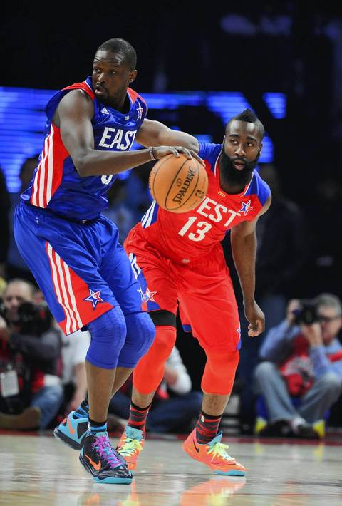 Luol Deng controls the ball against James Harden.
