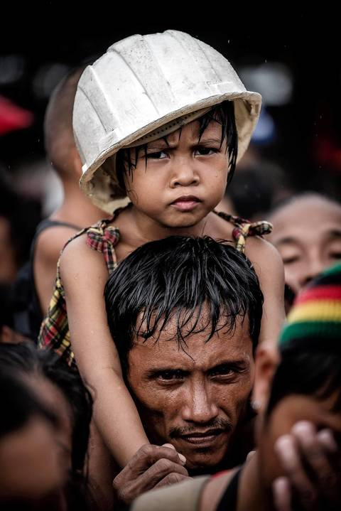 Typhoon victims wait to be evacuated in Tacloban.