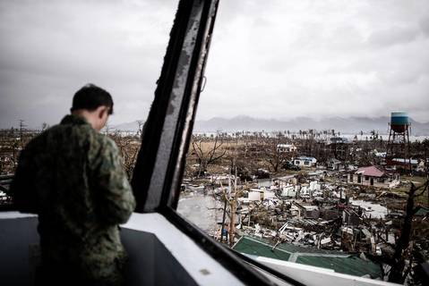 A Filipino soldier stands in the damaged control tower of the airport in Tacloban.