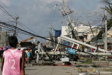 Downed power lines and debris block the road in the aftermath of Typhoon Haiyan on Nov. 10.