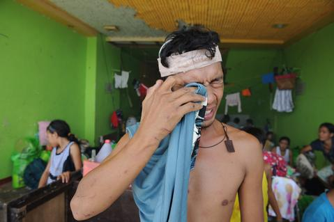 A resident who survived Typhoon Haiyan cries inside a stadium used as an evacuation centre in Tacloban, Leyte province, central Philippines, on Nov. 10.