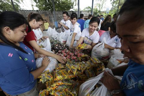 Volunteers prepare relief bags inside the Department of Social Welfare warehouse in Manila, Philippines, on Nov. 9.