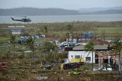 A general shot shows fallen trees and destroyed houses in the aftermath of Super Typhoon Haiyan in Tacloban, eastern island of Leyte, on Nov. 9.