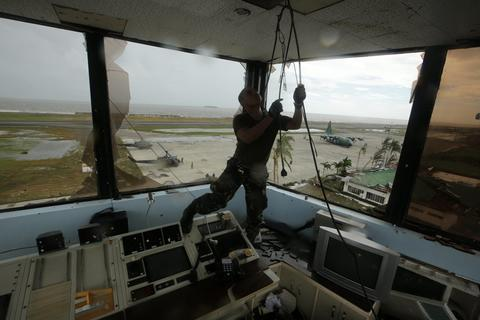 A soldier pulls a cable inside the devastated airport tower in Tacloban city, Leyte province, Philippines, on Nov. 9.