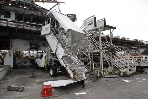Damaged passenger boarding stairs are seen after super Typhoon Haiyan battered Tacloban city, central Philippines, on Nov. 9.
