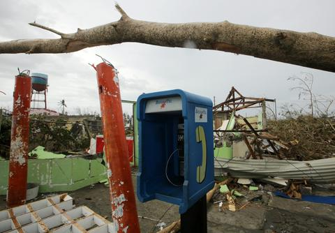 A telephone booth is surrounded by debris in the typhoon devastated city of Tacloban, Leyte province, Philippines, on Nov. 9.