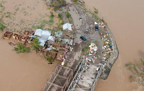 An aerial shot shows devastation in the aftermath in the aftermath of Typhoon Haiyan that smashed into coastal communities on the central Philippines.