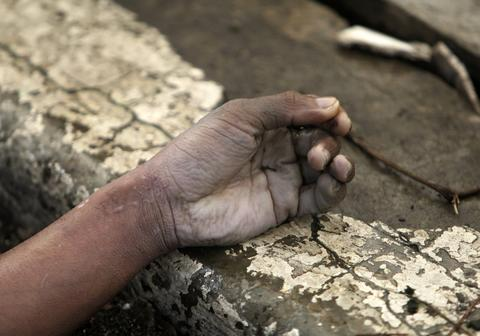 The hand of a victim in the super typhoon devastated city of Tacloban, Leyte province, Philippines, on Nov. 9.