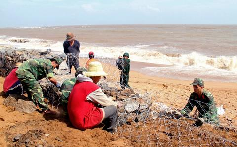 Soldiers and workers reinforce a sea dyke in the central province of Phu Yen after Typhoon Haiyan battered Tacloban city, central Philippines, on Nov. 9.