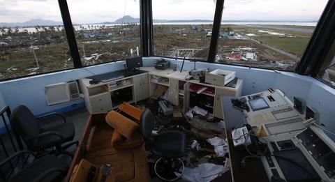Survivors assess the damage after super Typhoon Haiyan battered Tacloban city, central Philippines Nov. 9.
