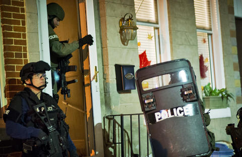 Baltimore police outside a home in the 1600 block of East Lanvale Street after the home was forcibly entered.