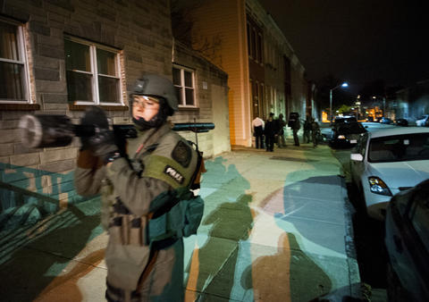 SWAT member leaves the scene of a forced entry in the 1600 block of East Lanvale Street.