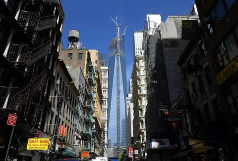 The final section of the spire sits on top of One World Trade Center in New York after it was fully installed on the building's roof. With the spire now in place, One WTC will stand 1,776-feet tall, making it the tallest building in the Western Hemisphere.