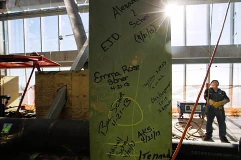 Graffiti is written on a steel girder on the 105th floor of One World Trade Center after the final piece of the building's spire was attached in New York.