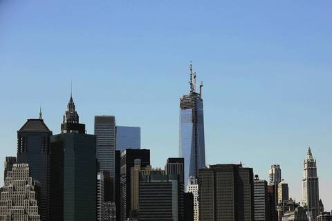 The 408-foot spire is seen after it was hoisted onto a temporary platform on the top of One World Trade Center.