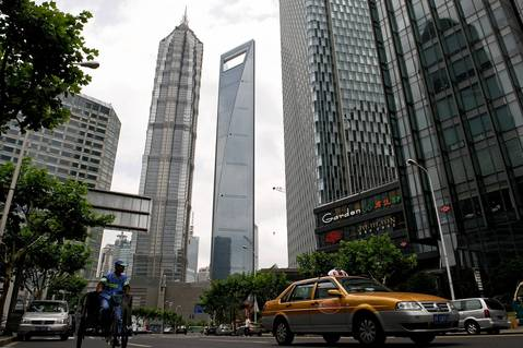 No. 5 The 101-storey, 1,614 foot, World Finance Center, center with opening at top, in the Pudong financial district in Shanghai.