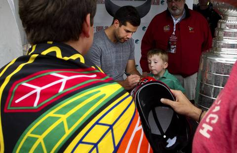 Chateauguay native and Chicago Blackhawks goalie Corey Crawford greets fans and signs autographs as he visits his former hometown in Montreal on Monday, Sept. 2